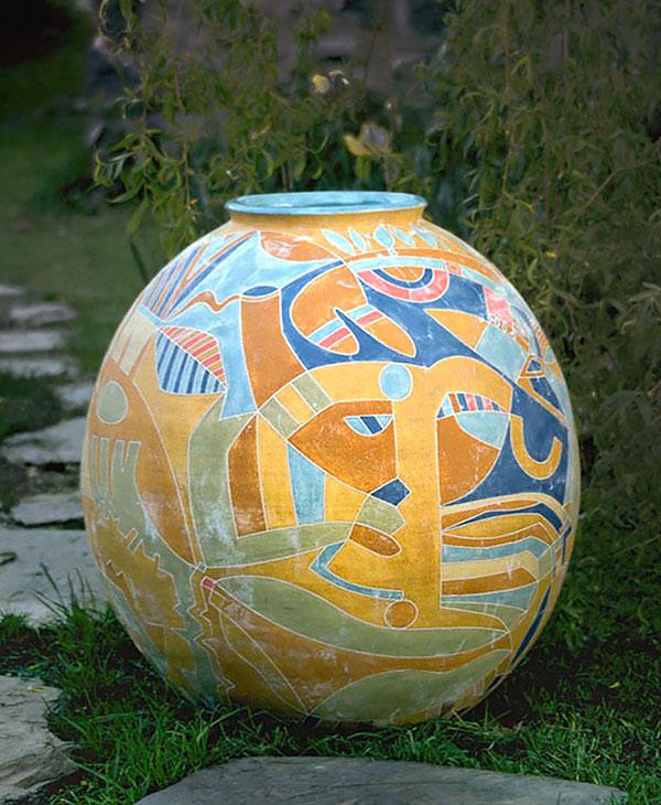 A multi-coloured slip decorated Garden Urn by Linda John