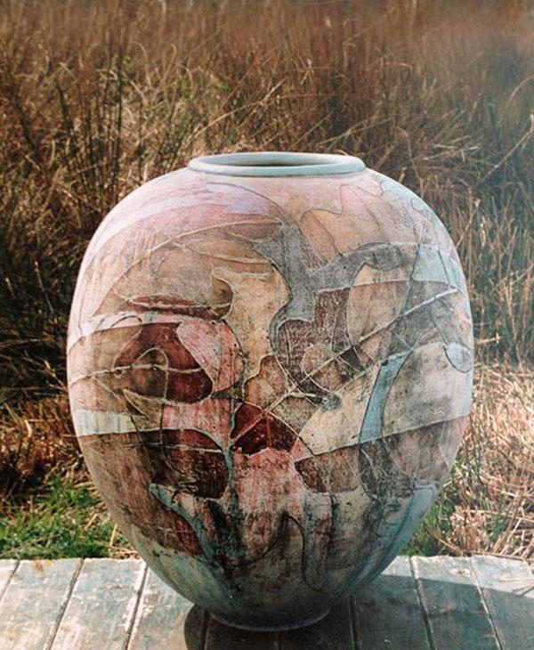 A large garden urn by Linda John using multi-layered decoration.