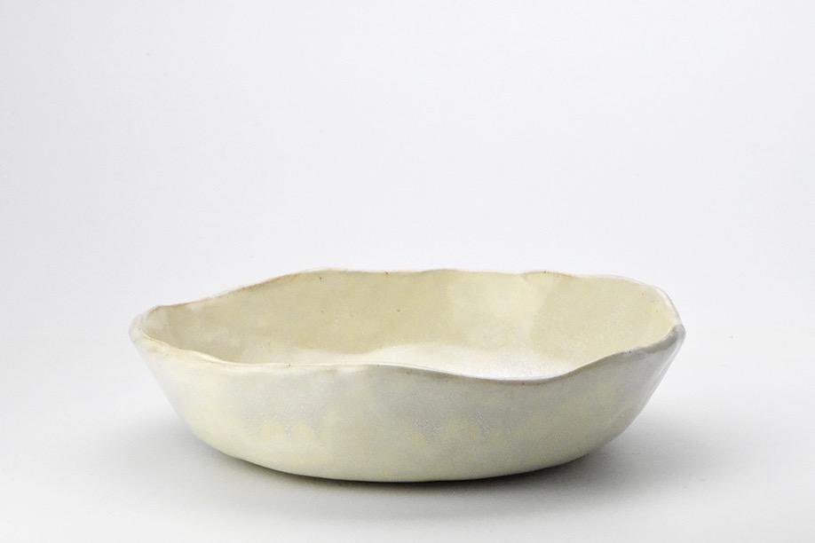 Subtle pinched cream bowl.