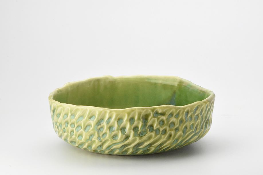Pinched bowl with textured surface.
