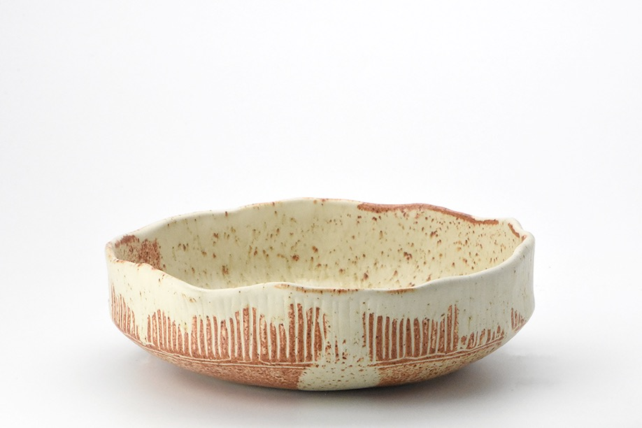 Pinched bowl with stripes.